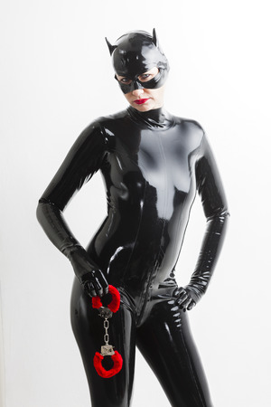 domina: portrait of woman wearing latex clothes with handcuffs