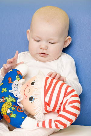 defenceless: portrait of baby with toy Stock Photo