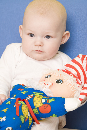 0 1 months: portrait of baby with toy Stock Photo