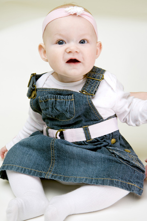 6 12 months: sitting baby girl Stock Photo