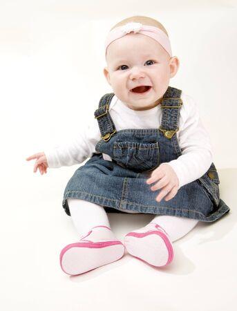 girl sitting down: sitting baby girl Stock Photo