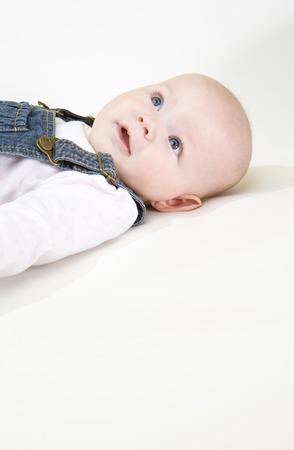 6 12: portrait of lying down baby girl