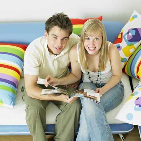 couple sitting on sofa photo