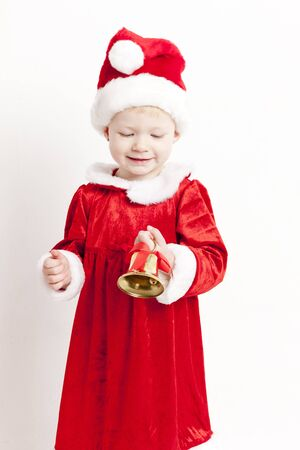 little bell: little girl as Santa Claus with a bell Stock Photo