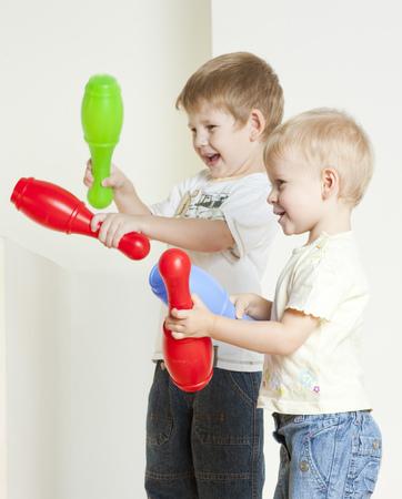 skittles: standing children playing with skittles Stock Photo