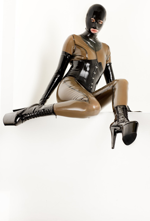 extravagancy: sitting woman wearing latex clothes
