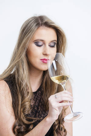 portrait of young woman with a glass of white wine Stock Photo