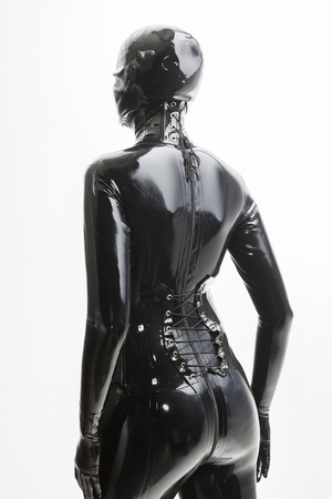 latex woman: portrait of standing woman wearing latex clothes