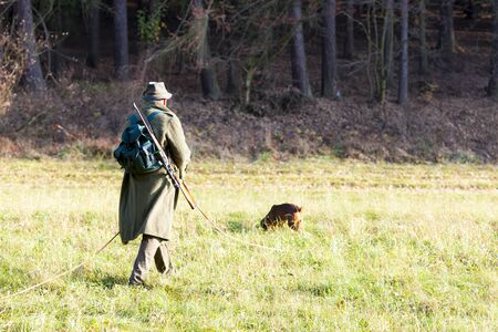 outside shooting: hunter with his hunting dog