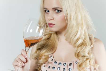 rose wine: portrait of young woman drinking rose wine