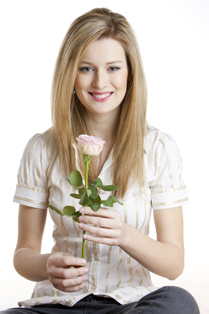 fair haired: portrait of young woman with a rose