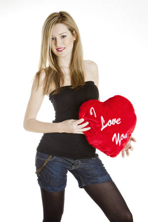 saint valentine   s day: standing young woman with heart