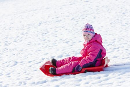 little one: little girl with bob in snow Stock Photo