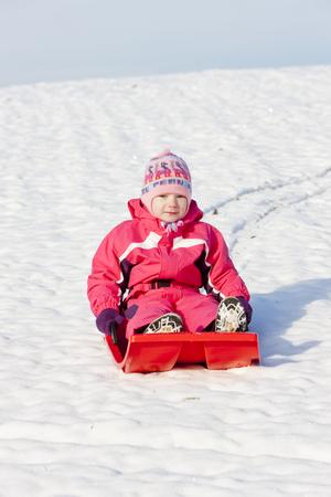 bob: little girl with bob in snow Stock Photo