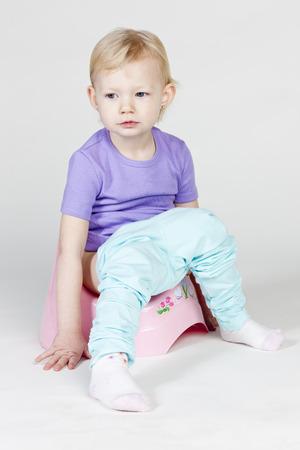 little girl using potty