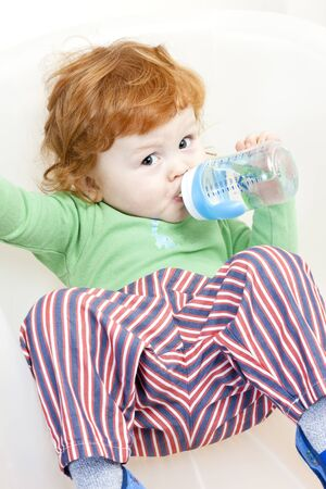 botle: sitting little boy with a botle of water