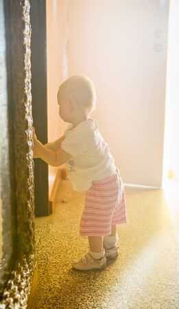 defenceless: standing toddler in a room