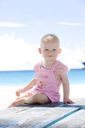 windward: toddler on the beach, Barbados, Caribbean