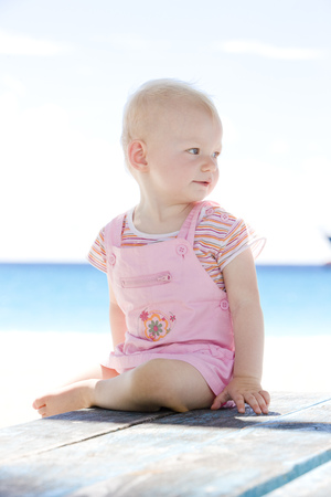 defenceless: toddler on the beach, Barbados, Caribbean