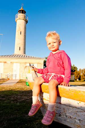 aquitaine: sitting little girl, Richard Lighthouse, Aquitaine, France