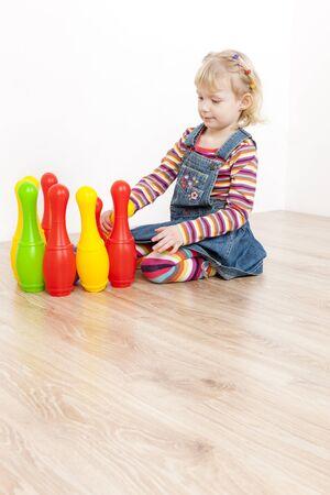 skittles: little girl playing with skittles