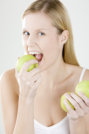 blond haired: woman with apples Stock Photo