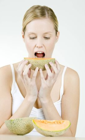blond haired: portrait of woman with water melon