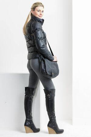 black boots: woman wearing platform black boots with a handbag