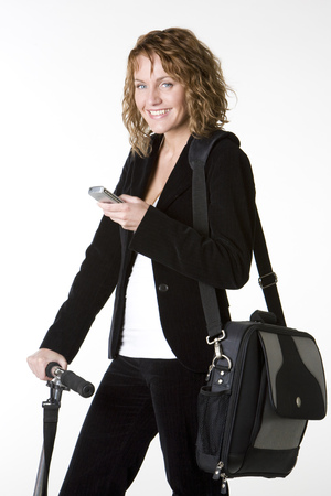 telephoning: businesswoman with mobile phone and notebook