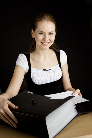 portrait of businesswoman with folders photo