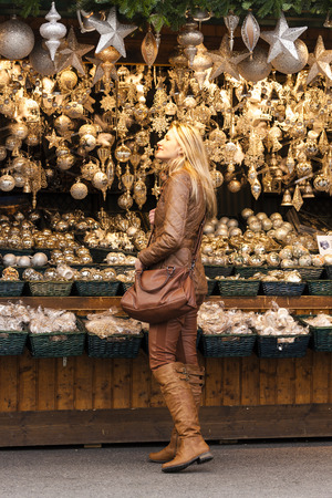 christkindlmarkt: woman at Christmas market, Vienna, Austria