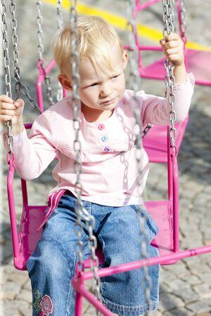 atraction: little girl on carousel
