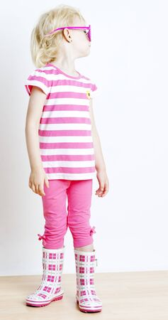 wellingtons: little girl with fashionable glasses Stock Photo