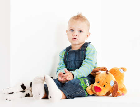 defenseless: sitting toddler with toys
