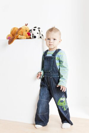 infantile: standing toddler with toys