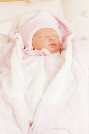 swaddling: portrait of a newborn baby girl Stock Photo