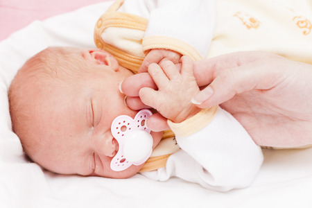 portrait of sleeping newborn baby girl
