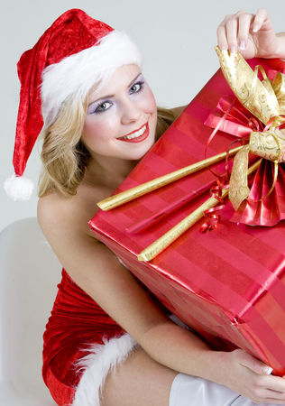 giftwrapped: Santa Claus with Christmas present