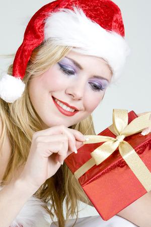 Santa Claus with Christmas present photo