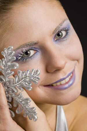 christmas ornamentation: portrait of woman with snowflake