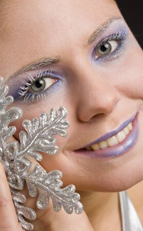 christmas ground: portrait of woman with snowflake