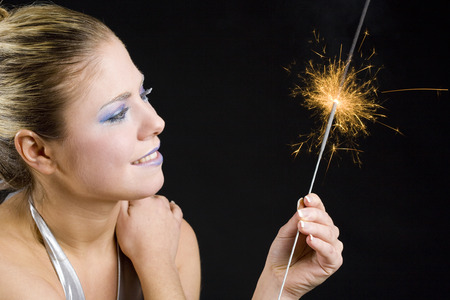 portrait of woman with fire-cracker photo