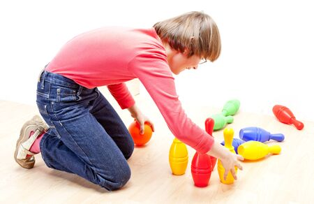 skittles: girl playing with skittles Stock Photo