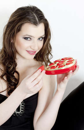 saint valentine   s day: portrait of young woman with Valentine?s chocolate box Stock Photo