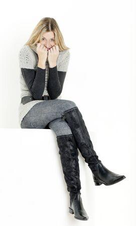 leggings: sitting woman wearing fashionable boots Stock Photo