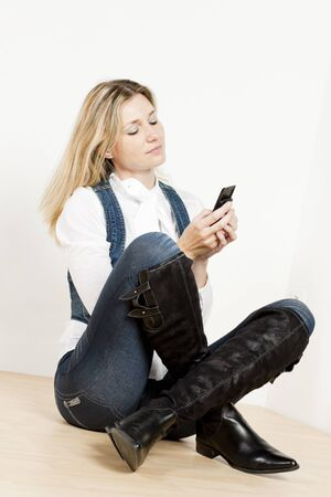 mobilephones: sitting woman with mobile phone