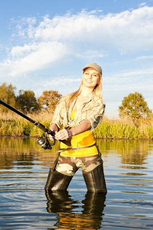 woman fishing in pond Stock Photo