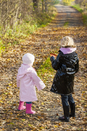 rubber boots: little girls wearing rubber boots in autumnal nature