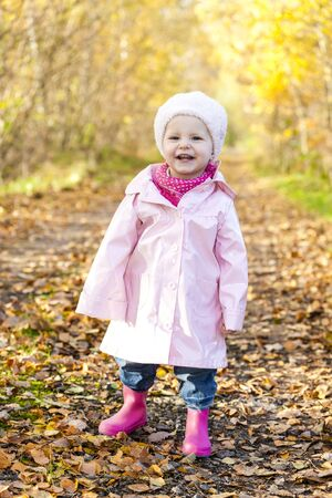 rubber boots: little girl wearing rubber boots in autumnal nature