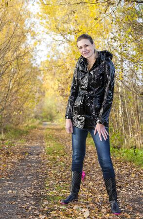 woman wearing rubber boots in autumnal nature Stock Photo